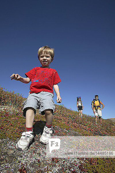 Closeup of Boy in Family hiking together in Arctic Valley Chugach State Park Southcentral Alaska Summer