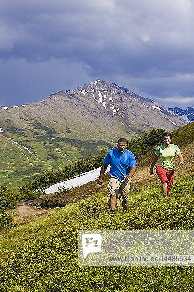Couple hiking trail below Flat Top Mountain  Glenn Alps area  Chugach State Park  Southcentral Alaska