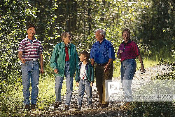 Family walking on trail Anchorage SC Alaska summer scenic portrait