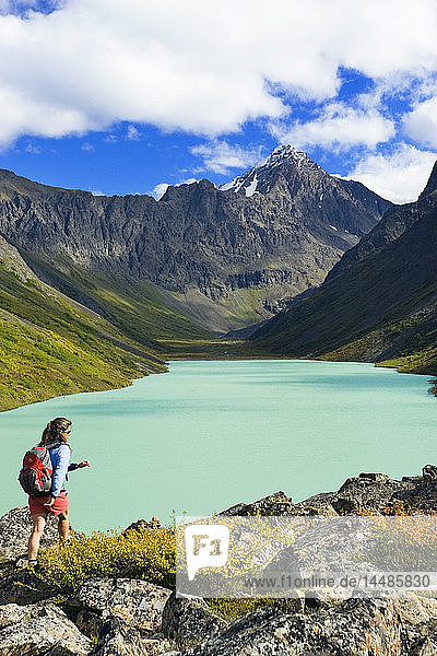 Female hiking at Eagle Lake in Chugach State Park on South Fork Eagle River Trail in Alaska Autumn