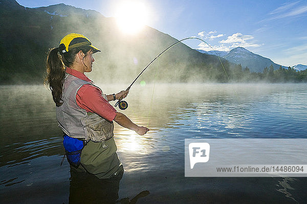 Angler flyfishing for Rainbow Trout in Portage Valley in early morning  Southcentral Alaska