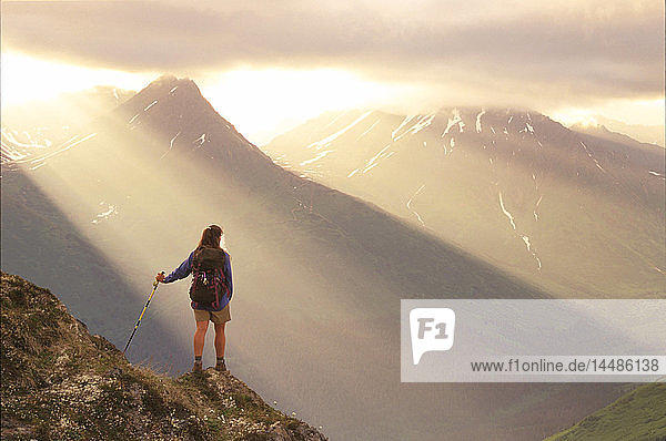 Woman Hiking on Birdge Ridge Sun Rays Chugach NF Alaska