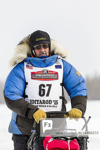 Musher Chuck Schaeffer competing in the 2015 Iditarod Trail Sled Dog Race on the Chena River after leaving the restart in Fairbanks in Interior Alaska.
