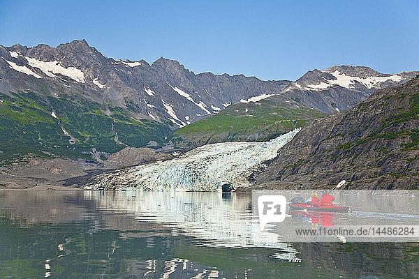 A Couple kayaking in Upper Shoup Bay  Shoup Glacier background  Shoup Bay State Marine Park  Prince William Sound  Alaska