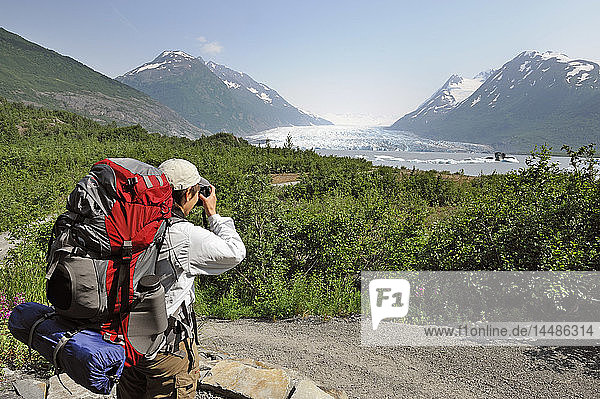 Female Hiker stops for a photo along the trail to Spencer Glacier  Southcentral Alaska