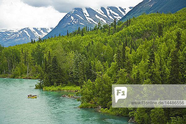 Scenic view of family rafting on the Kenai River near Cooper Landing on the Kenai Peninsula during Summer in Alaska