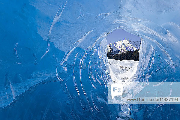Male ice climber inside ice cave Mendenhall Glacier Tongass National Forest Southeast Alaska Spring