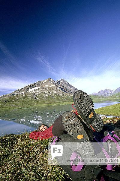 Hiker Resting at Shoreline of Lost Lake KP Alaska