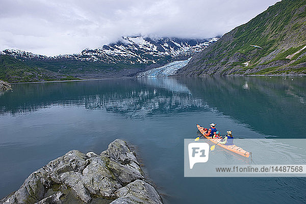 Family kayaking in Shoup Bay with Shoup Glacier in the background  Prince William Sound  Southcentral Alaska