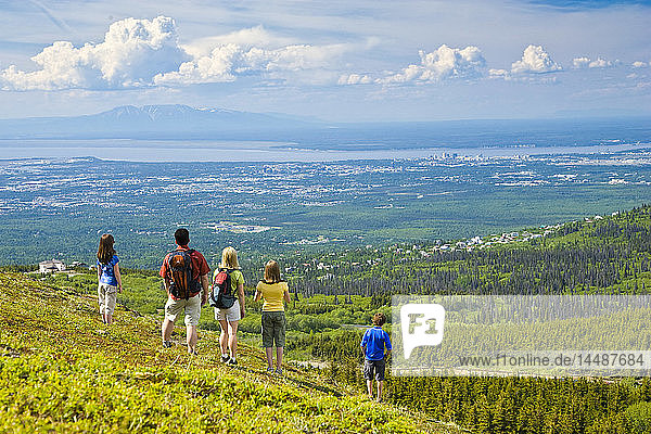Family hiking in the Glen Alps area overlooking Anchorage  Southcentral Alaska
