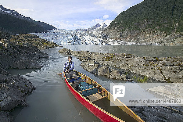 Canoeist on Mendenhall Lake SE Alaska Summer Tongass NF near Mendenhall Glacier