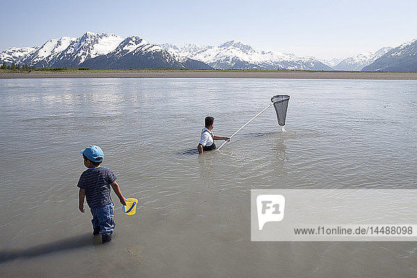 Father and son dipnet fishing for hooligan along Seward Highway  Southcentral Alaska