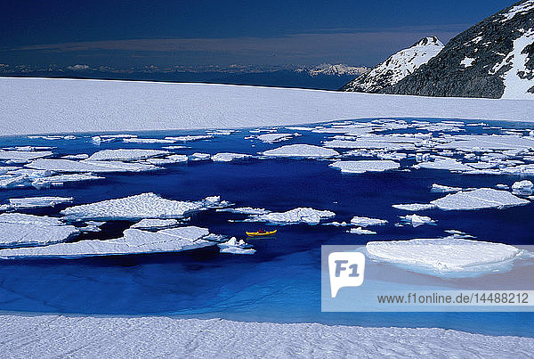Woman Relaxing in Kayak Blue Melt Pond Juneau Icefield AK