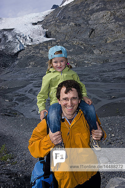 Father and young daughter hiking on a path in front of the Worthington Glacier  Chugach National Forest  Southcentral  Alaska