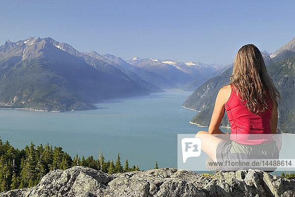 Hiker on Rock Overlooks Chilkoot & Taiya Inlet AK SE Summer Mt Riley near Haines
