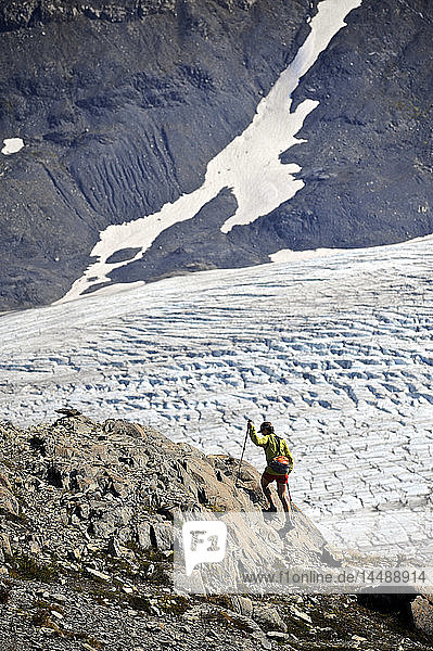 Woman hiking alongside Exit Glacier in the Harding Icefield  Kenai Fjords National Park  Kenai Peninsula  Southcentral Alaska  Summer