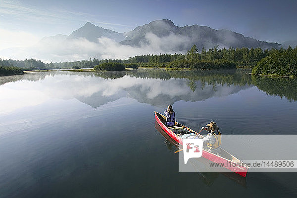 Couple Canoeing on Lake Portage Valley SC AK Summer