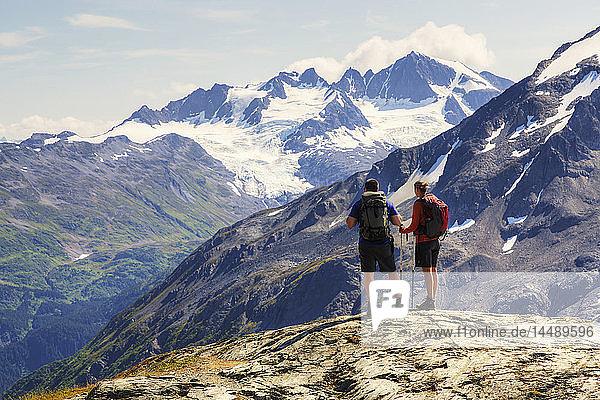 Man and woman enjoying the view from the Harding Icefield Trail near Seward  Kenai Fjords National Park  Kenai Peninsula  Southcentral Alaska  Summer  HDR