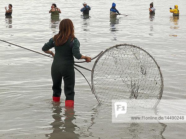 Crowd of people dip net on the Kenai River during Summer  Kenai Peninsula  Southcentral Alaska