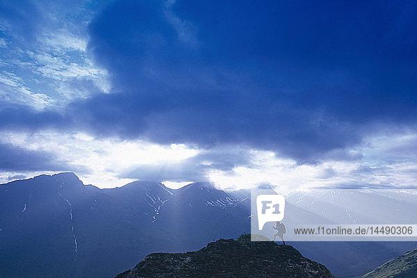 Woman Hiking on Bird Ridge Sun Rays Chugach NF Alaska