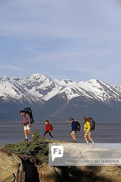 Family hiking on Rocks Turnagain Arm Southcentral Alaska summer scenic Kenai Mountains