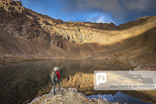 Male hiker enjoying the view of Hidden Lake  Chugach State Park  Southcentral Alaska