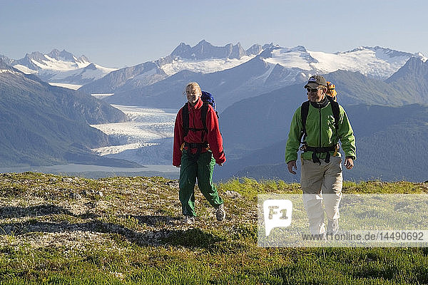 Couple hiking near Mendenhall Glacier Tongass National Forest Alaska Southeast