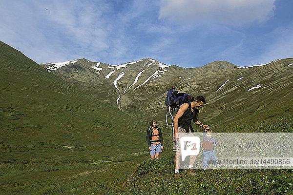 Man & Woman Hiking With Child Chugach State Park AK