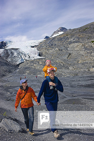 Family hiking on a path in front of the Worthington Glacier  Chugach National Forest  Southcentral  Alaska