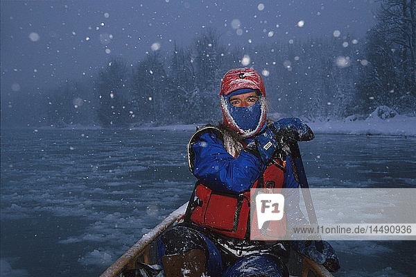 Woman Canoeing in Snowstorm Winter Kenai River KP AK