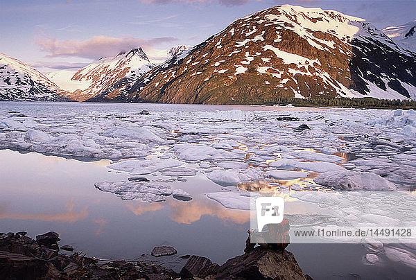 Hiker Sitting & View Portage Lake & Icebergs AK