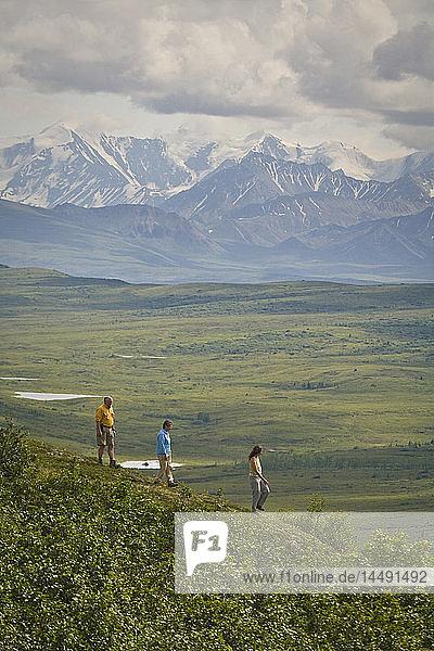 Hikers enjoying view near Wonder Lake in Denali National Park  Alaska during Summer