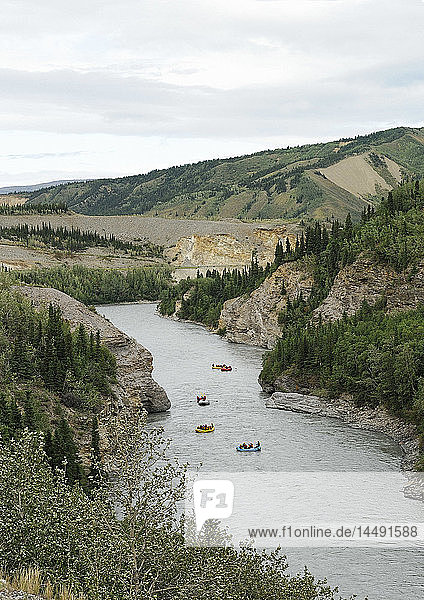 View of a group of rafters as seen from the Alaska Railroad´s Denali Star train as they are floating through the Nenana River Canyon north of Denali National Park  Interior Alaska  Summer
