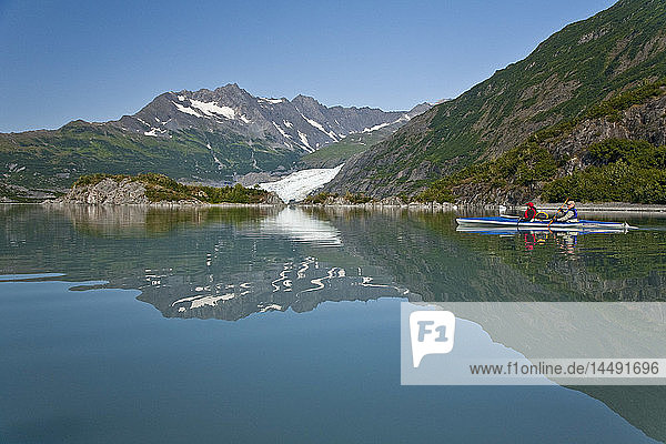 Man and woman kayaking in Upper Shoup Bay with Shoup Glacier in the background  Shoup Bay State Marine Park  Prince William Sound  Alaska