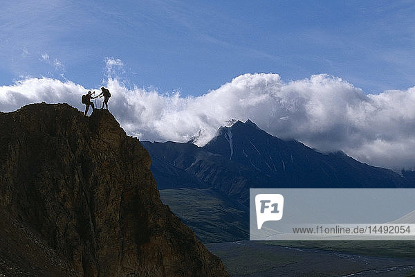 Couple Hiking Along Rock Outcrop @ Denali National Park Interior Alaska summer scenic