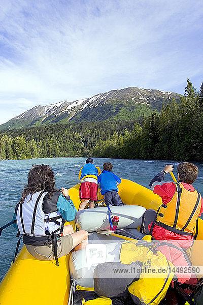 Family & guide river rafting on Kenai River Kenai Peninsula Alaska Summer