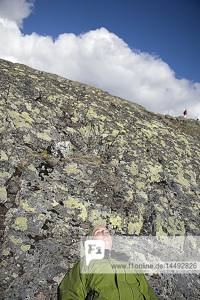 Woman resting on rock