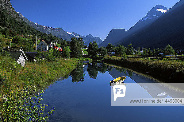 Rowing boat on lake in mountains