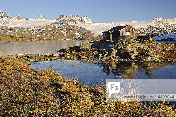 Scandinavia,  Norway,  View of cottage by lake, Scandinavia,  Norway,  View of cottage by lake
