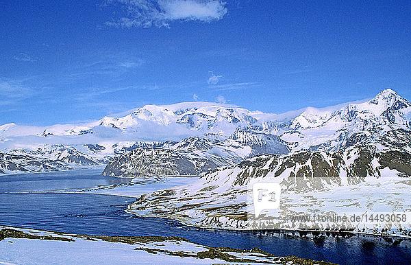 River flowing through snowcapped mountain range