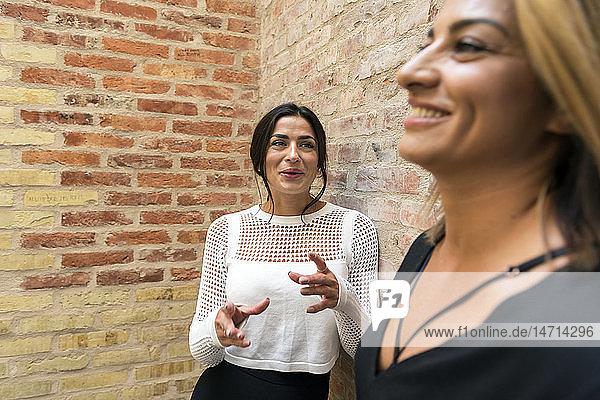 Smiling women talking