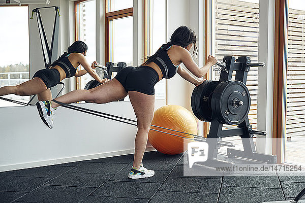 Woman excercising in gym