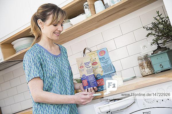 Woman using bicarbonate of soda.
