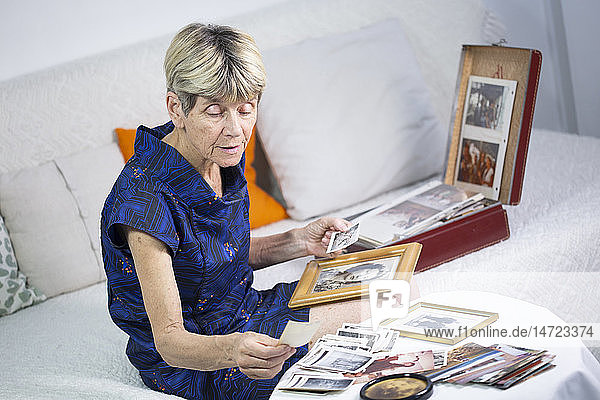 Old woman looking at photos.