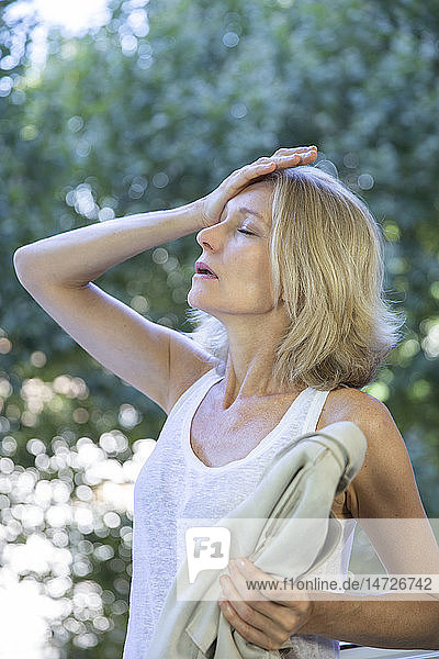 A menopausal woman having a hot flush.