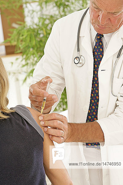 VACCINATING A WOMAN