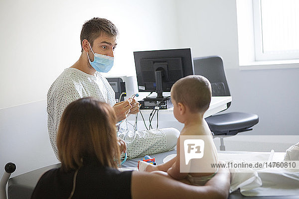 Reportage in the pediatric emergency unit in a hospital in Haute-Savoie  France. A doctor examines a young boy.