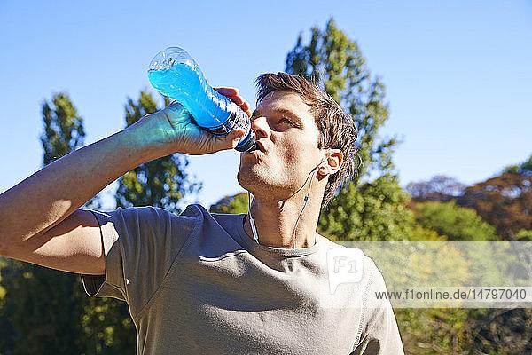Man drinking sports drink.
