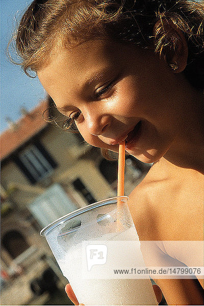 CHILD WITH COLD DRINK