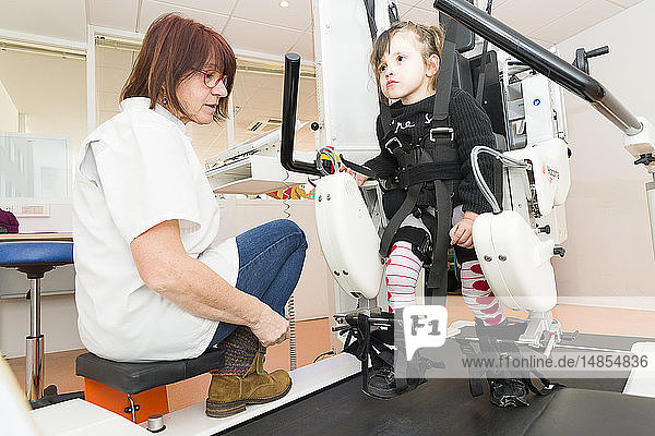 Reportage on the Rossetti health centre in Nice  France. This rehabilitation centre is a hub of excellence with cutting-edge technology. The Rossetti Motor Function Education Institute is the first French establishment to have a pediatric Lokomat PRO V6  an automated walking orthosis enabling intensive walking rehabilitation on a treadmill. This 4-year old girl suffers from neurological disorders and is late walking. She is having a training session with a physiotherapist.